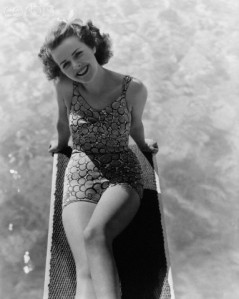ca. 1940 --- Actress Mildred Coles Wearing a Swimsuit --- Image by © John Springer Collection/CORBIS